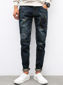 Patchy Worn Medium Wash Men's Jeans