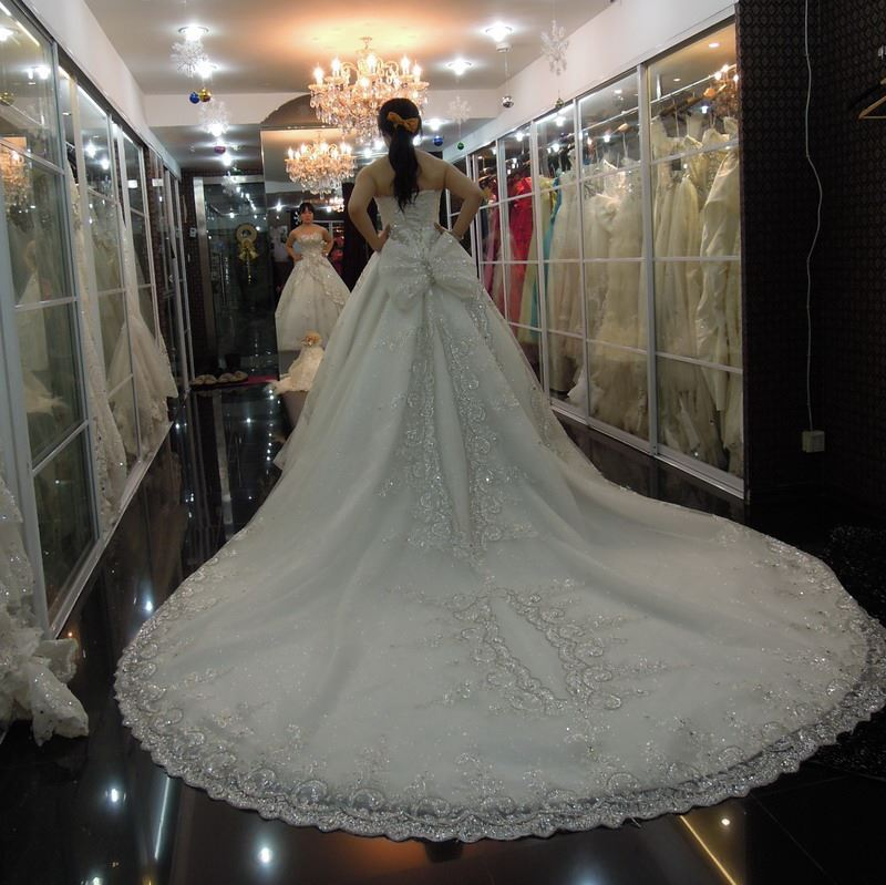 Luxurious Strapless Beaded Sweetheart Cathedral Wedding Dress
